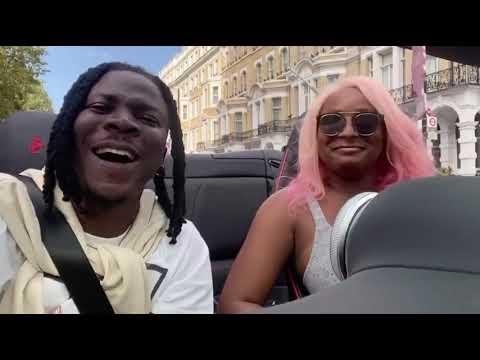 DJ Cuppy and Stonebwoy Rides In Her Ferrari