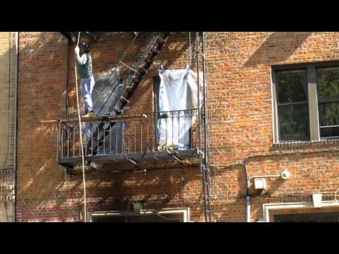 Scraping lead paint off fire escape