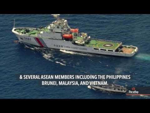 U.S. Navy ship sails near South China Sea reef
