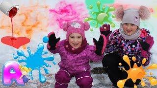 Anna and Yuliana play  with snow