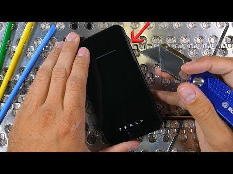Tesla makes a WIRELESS charger?! - Teardown