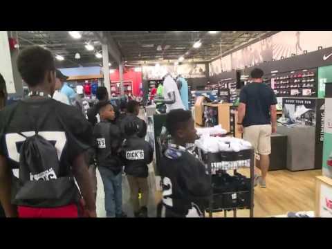Luke Kuechly surprises kids at shopping event