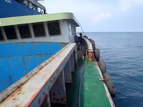 Lifting cargo from the barge H45 to MV Ocean carrier hold n5.MP4
