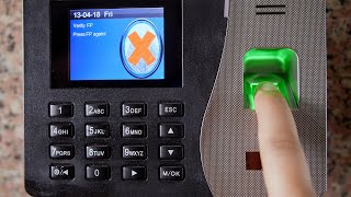 A girl trying to get the correct finger scanning on an attendance machine