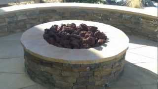 Denver Landscape Contractor Installing Flagstone Patio, Gas Fire Pit, And Seat Wall In Erie Colorado
