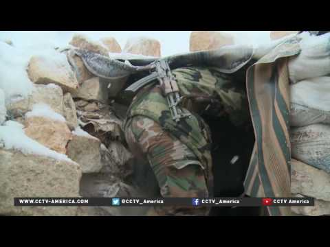 Sole female soldier fights in brutal Aleppo conflict