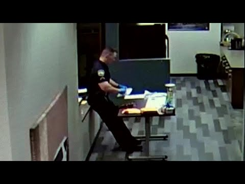 WATCH: Officer collapses while packing up drug evidence laced with fentanyl