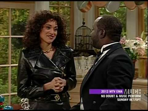 Karyn Parsons in a pvc coat