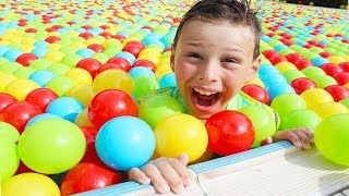 Ali filled swimming pool with colored balls Fun Kids video