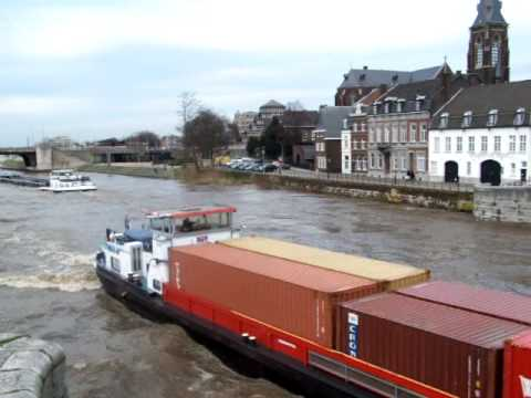 Big riverboats on the wild river Maas Maastricht Holland