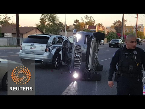 Uber halts driverless car program after Arizona crash
