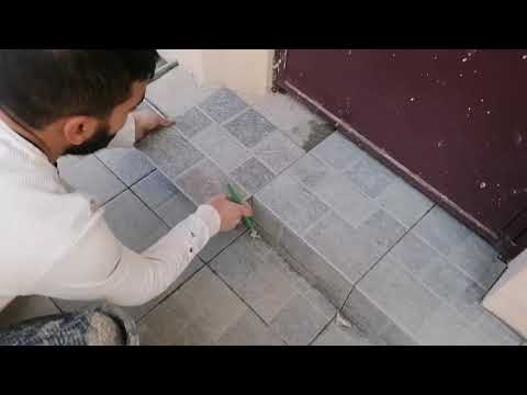 The worker who makes the tile dance - you need to see