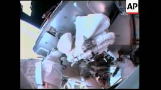 Discovery airlock hatch opens, astronauts begin 1st spacewalk
