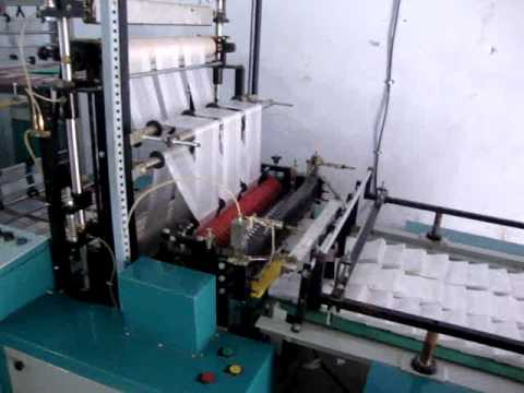 PLASTIC BAG CUTTING & SEALING MACHINE