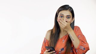 Surprised Indian woman using her mobile phone in casual wear - modern lifestyle