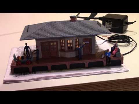 Plasticville passenger train station, with moving people. For O gauge train platform