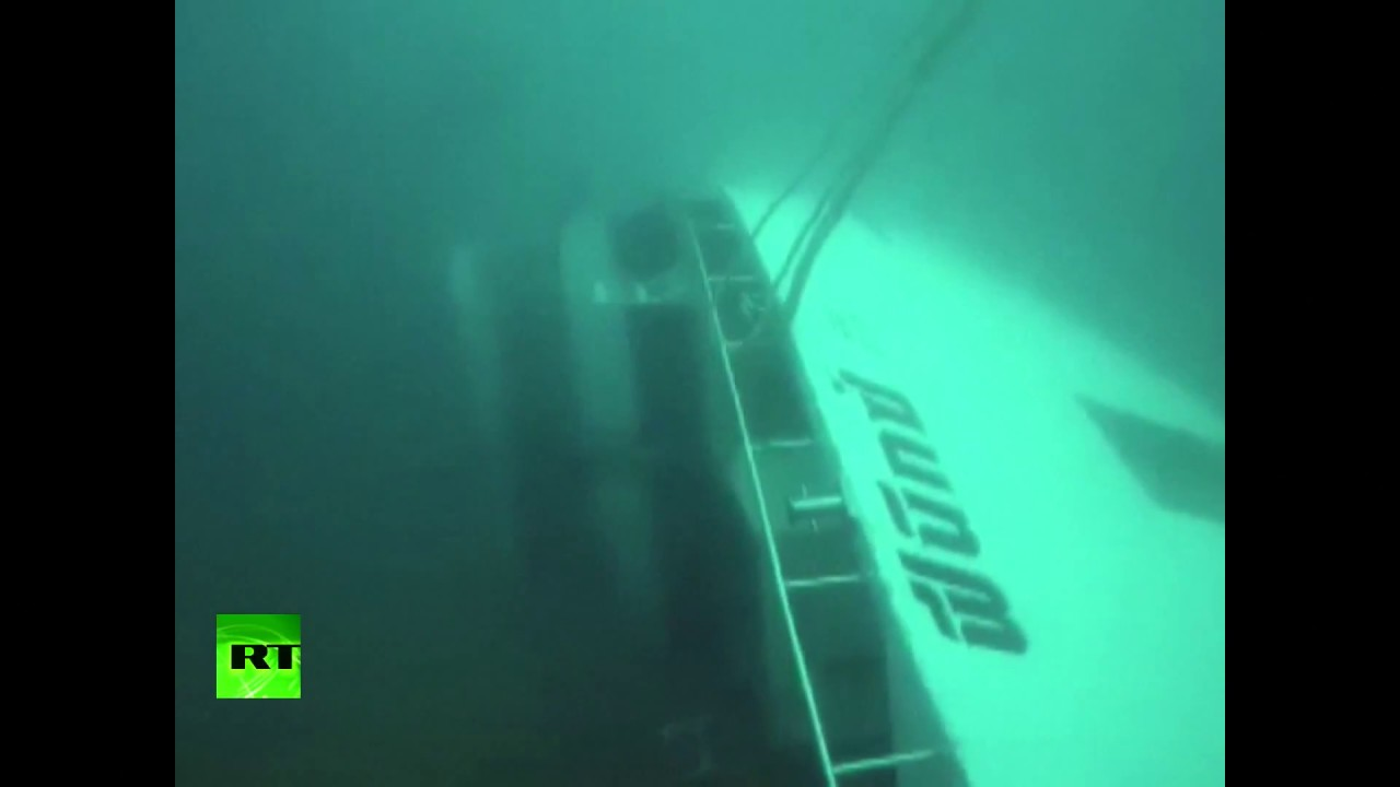 RAW: Boat filmed underwater after capsizing off Thailand, at least 42 found dead