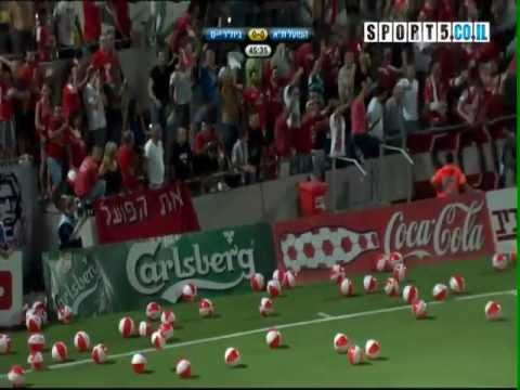 football fans throwing Thousands of beach balls to the field