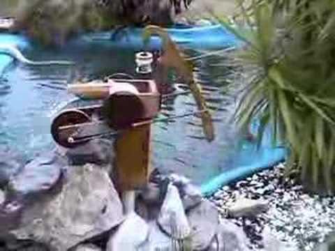 Water Wheel Powered Pond Pump Youtube