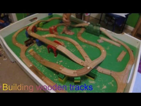 Kids building wooden train set on train table - FUN TIMES