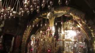 A procession of a monk at Golgotha ​​(Calvary), Church of the Holy Sepulchre, Jerusalem. Nov 4, 2014
