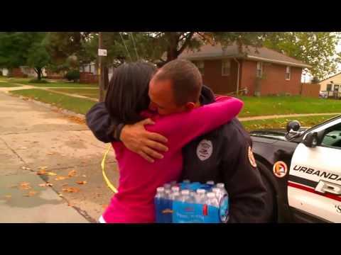 Tearful hugs as woman brings water to Urbandale officer