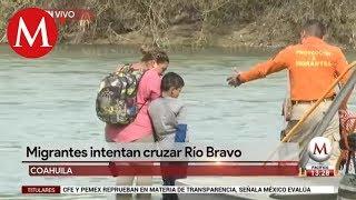 Migrantes intentan cruzar Río Bravo