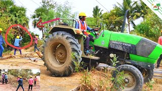 DEUTZ FAHR Tractor picking up power line tower   Extreme Jobs High Voltage Power Line With Tractor
