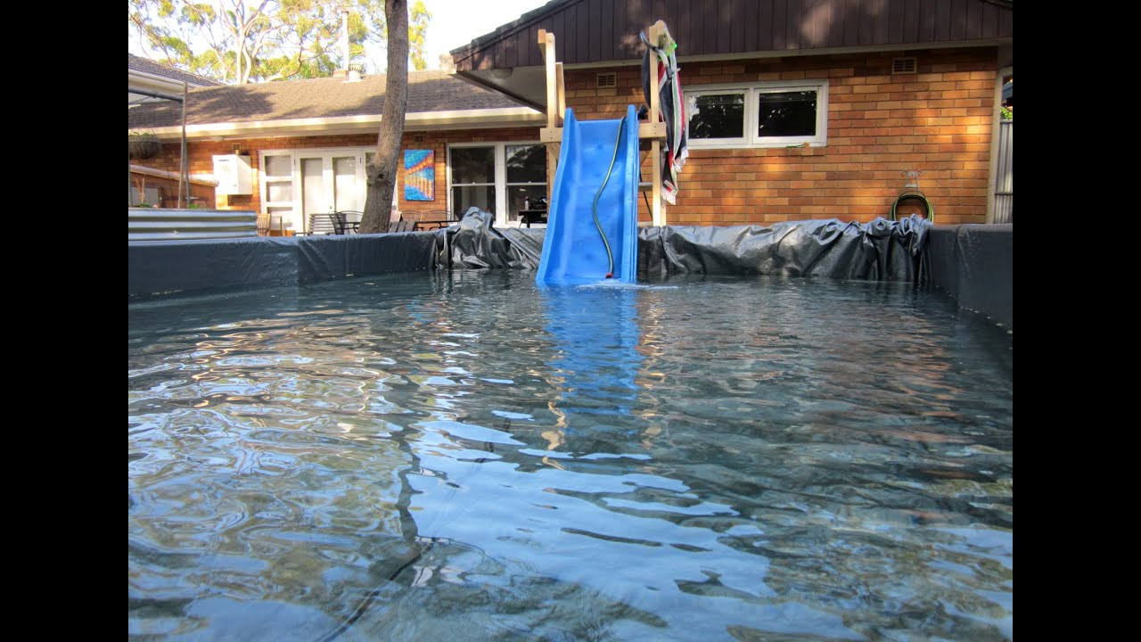Man builds giant paddling pool in backyard youtube for Biggest paddling pool