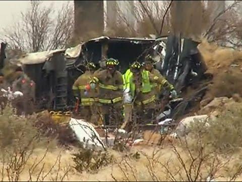 Raw: 10 Killed As Prison Bus Strikes Train in TX