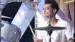 TOKIO's drummer Matsuoka Masahiro rocking his drums during TOKIO's ...