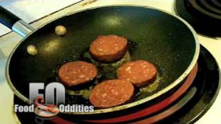Remy Eats Blood Sausage (Food Oddities - www.foododdities.com)