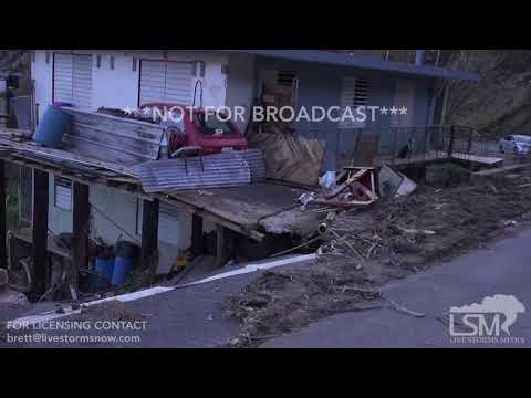 10-2-2017 El Yunque rainforest destroyed by Hurricane Maria, people doing laundry in river, extreme