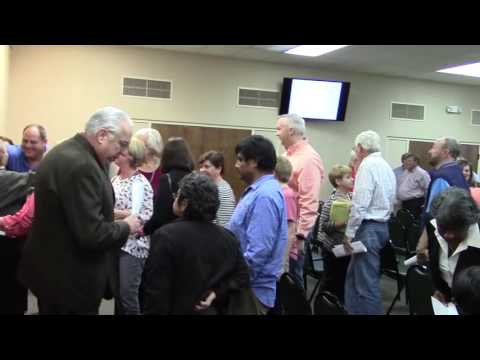 The crowd exits the room at the end of county cases