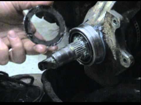 Polaris Scrambler 500 4x4 -- Front Hub Work - YouTube