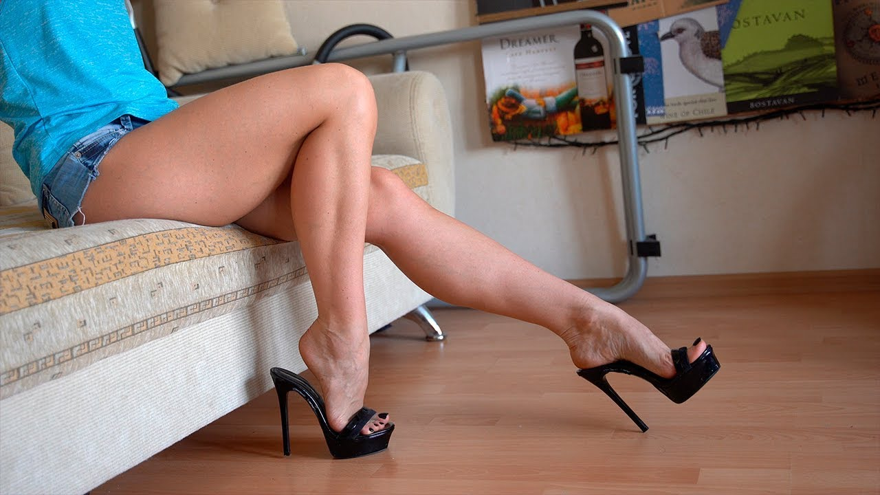 Pretty girl with perfect feet shows her legs and high heels - Mules