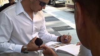 Tom Milone of The Oakland Athletics signing autographs