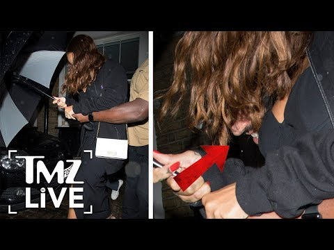 Rihanna Hides Boyfriend Under Her Umbrella | TMZ Live
