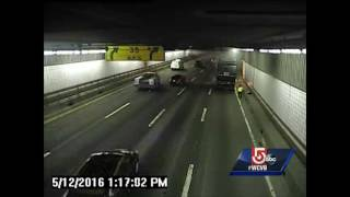 Surveillance video shows trash truck catching fire inside tunnel