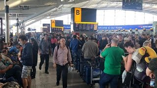 Stranded British Airways passengers slowly make way home after computer outage