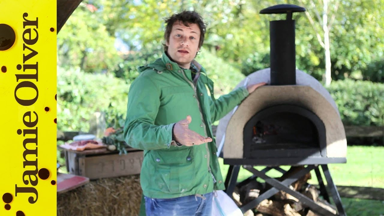 Jamie Oliver shows you how to cook pizza in a wood fired oven  YouTube