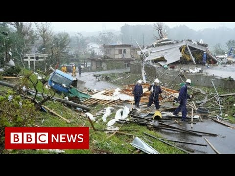 Japan hit by biggest typhoon in decades – BBC News