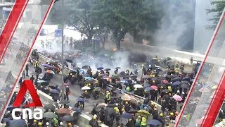 Hong Kong police fire tear gas, water cannon at protesters outside government headquarters