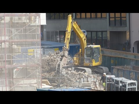 Komatsu PC138US and a Brokk remote controlled demolition robot demolition a Hotel