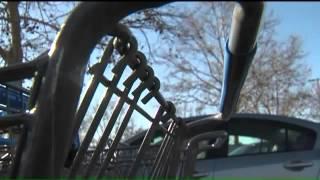 People putting razor blades on walmart shopping carts