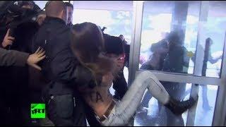 Video: Berlusconi survives Femen booby trap