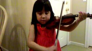Emma warming up the violin!