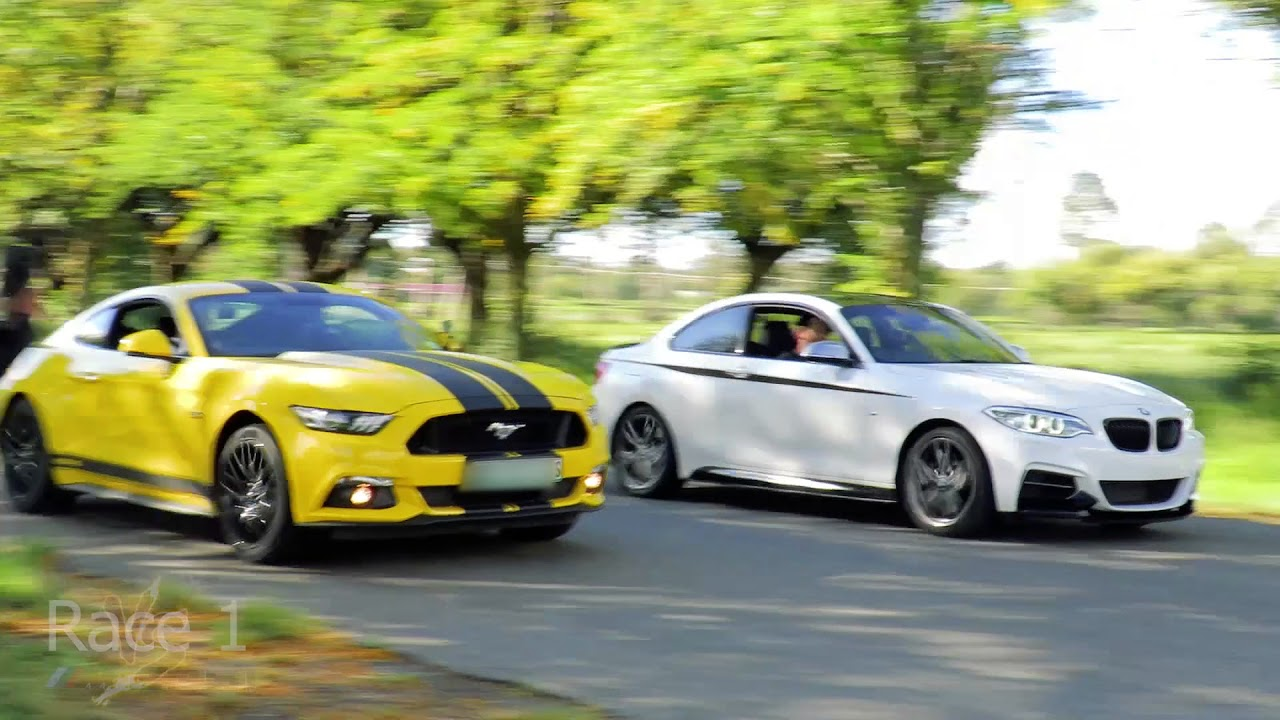 Bmw M235i Vs 2017 Ford Mustang Gt Drag Race