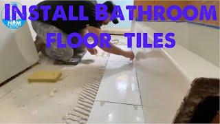 Installing bathroom ceramic tiles