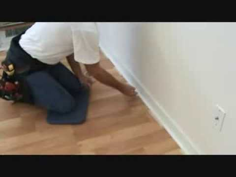 Installing baseboard quarter round trim to a laminate floor